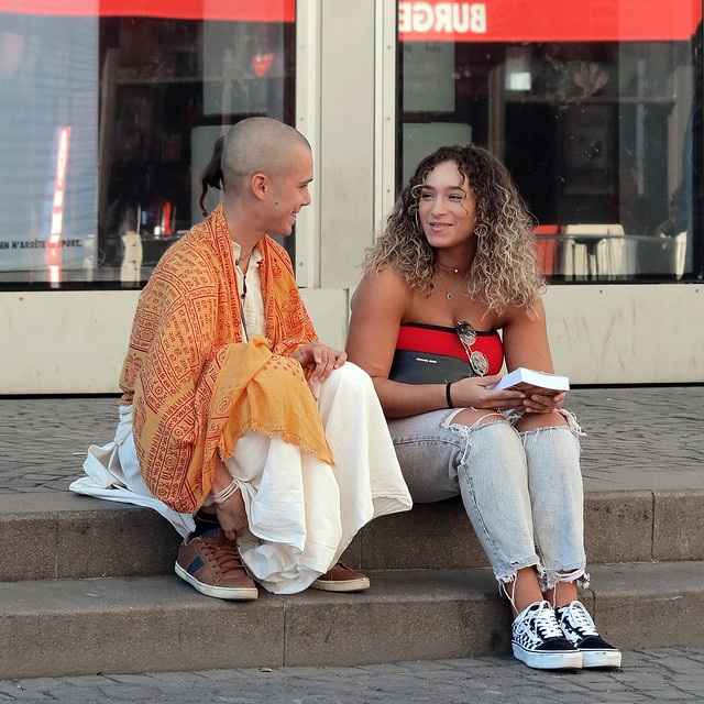 A member of the Hare Krishna movement making female adepts