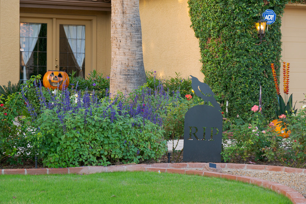 A flower garden is adorned with Halloweeen decorations in the Buenavente neighborhood of Scottsdale, Arizona on October 28, 2018. Original: _DSC9016.arw