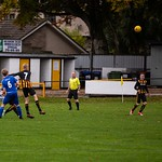 Alex Davidson (7) heads the ball away