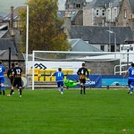 Cameron Middleton saves Max Taylor's (9) penalty touching it onto the post