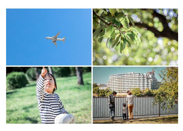 平和公園でファミリーフォト 晴天を飛ぶ飛行機