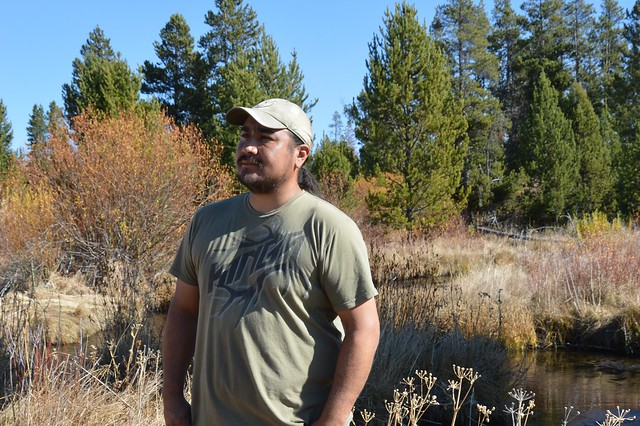 Burns Paiute Tribal Vice-Chair Eric Hawley observes the new growth along the banks of Big Creek