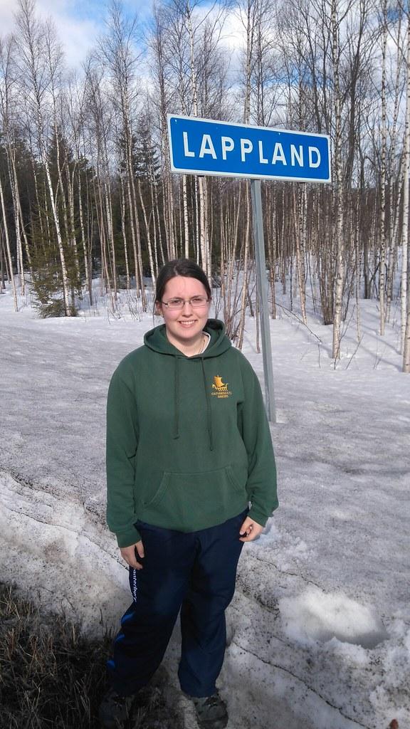 Anja Johnson Erasmus+ participant by Lapland sign