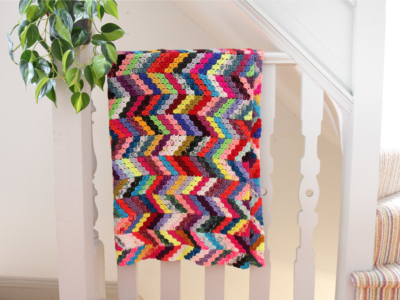 Ups + Downs blanket hanging on bannister