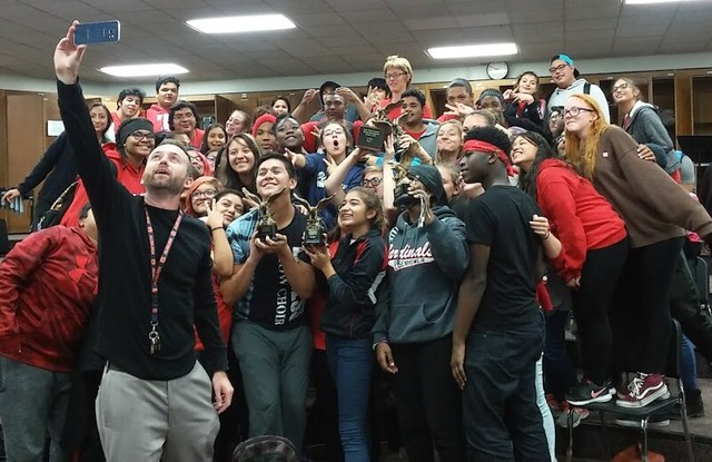 Justin Antos poses with band students.