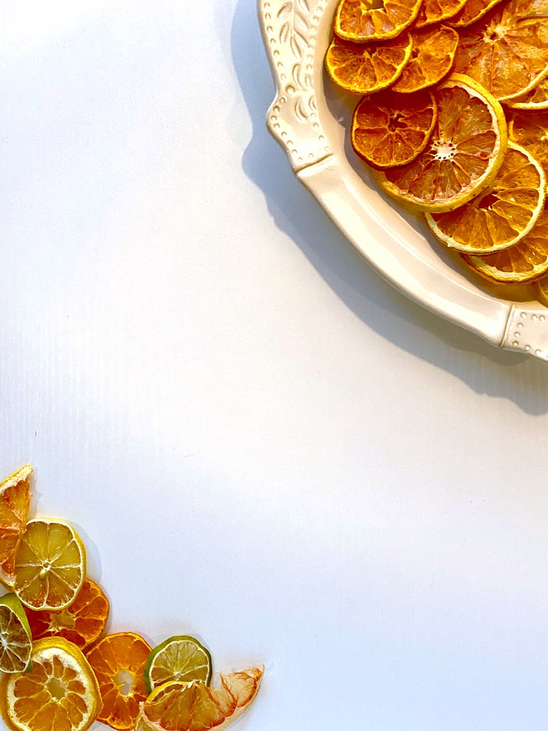 Citrus sitting on my desk on a plate.