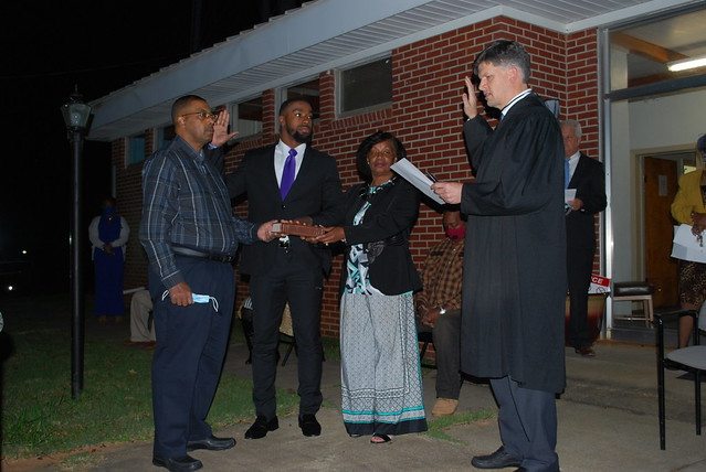 Messiah Williams-Cole with his parents, Juanice and Melvin Cole, is sworn in by Lee County Judge Mike Fellows.