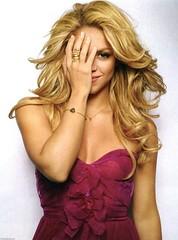Shakira covering her right eye