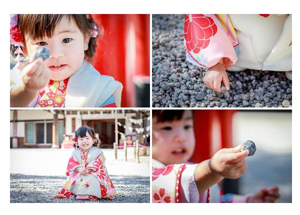 七五三 神社の境内で小石を集める3歳の女の子