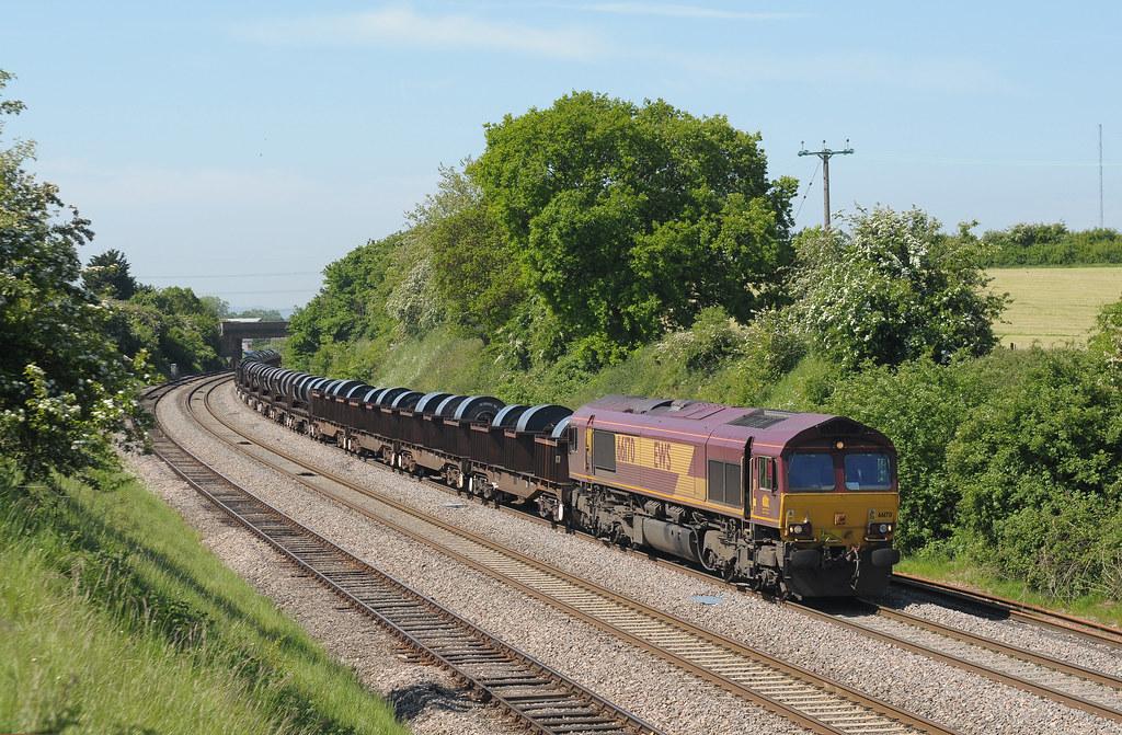 EWS Class 66 No. 66 170 hauls a heavily loaded 6M94, Margam to Corby, Steel coil train through Stoke Pound near Bromsgrove.