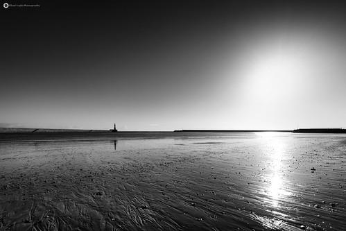 silenteaglephotography rockerbeach lighthouse sunderland northeast blancoynegro bw blackwhite sea water reflection rock sun sunset monkwearmouth cloud iso64 ƒ80 1500 tynewear seascape sunray 8500081 england