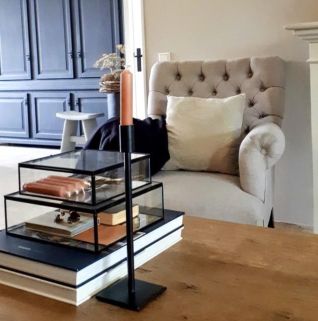 Boek Exclusief Stijlvol Wonen zwarte glazen box oranje accessoires landelijke woonkamer