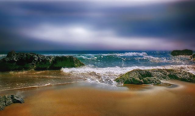 Los Escullos. Rocks, sand and sea.