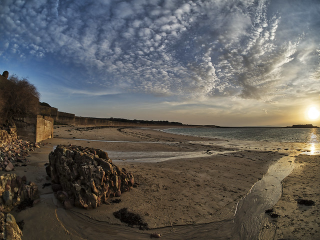 Hazy Sunrise over Longis Bay, Alderney - Fisheye