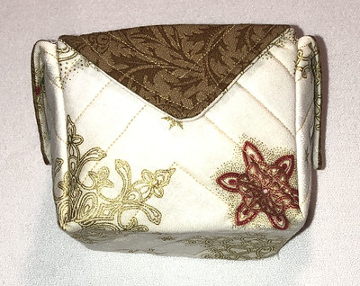 gold and brown fabric box