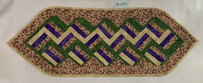 Green, white, purple, and tan zigzags;Autumn motif