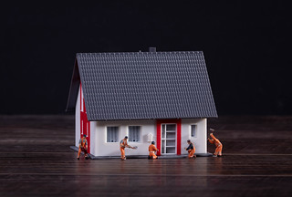 Miniature workers building a house | by wuestenigel
