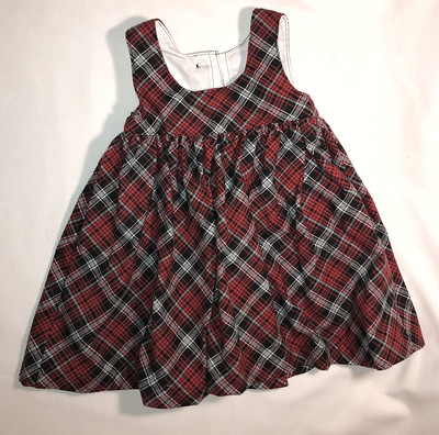 Red, gray, and black plaid flannel jumper, size 4