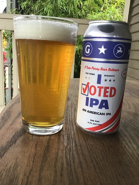 I Voted IPA can with glass, on table