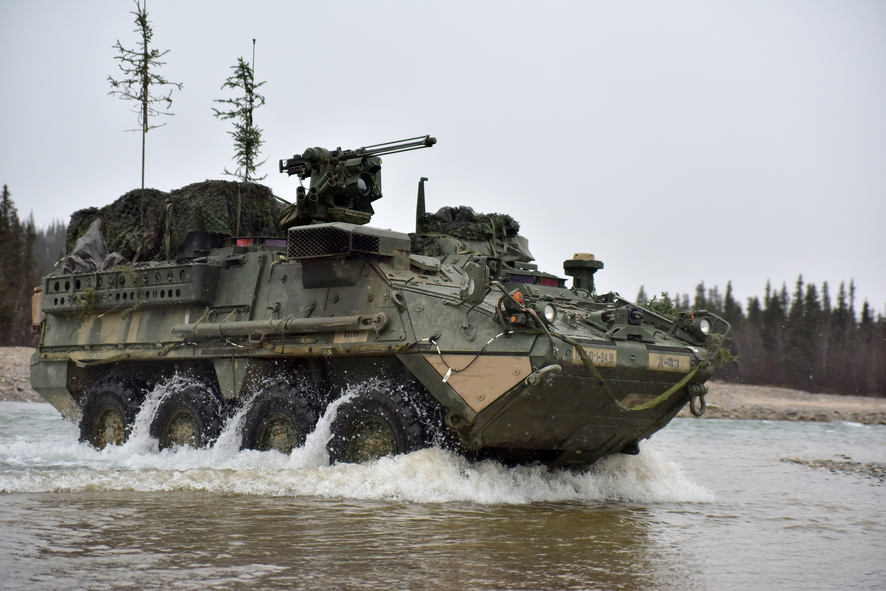 1st Stryker Brigade Combat Team, 25th Infantry Division cross Jarvis Creek in the Donnelly Training Area Oct. 19, 2018, during Arctic Anvil 19-01.