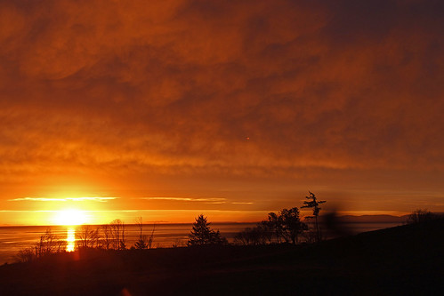 sunrise red sky royalbay colwood victoria bc silhouettes clouds landscape sun glow glowing