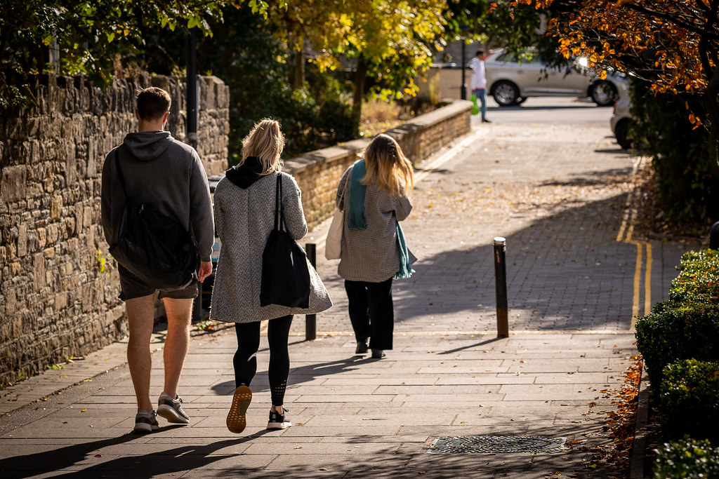 Students and Bath residents walking on a pedestrian route.