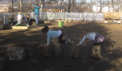 crawling over the stumps in the obstacle course