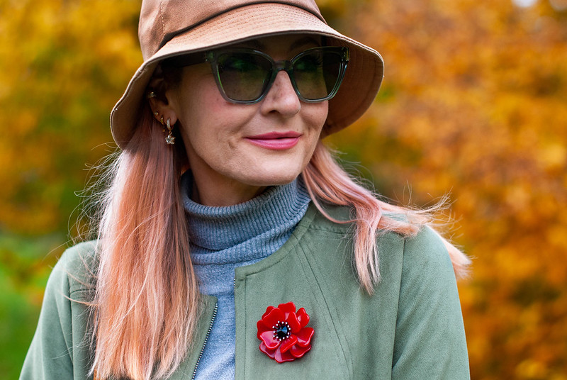 Styling That 90s Favourite, the Bucket Hat (worn with olive green longline jacket, jeans, grey roll neck sweater and brown knee-high boots) | Not Dressed As Lamb, Over 40 Style