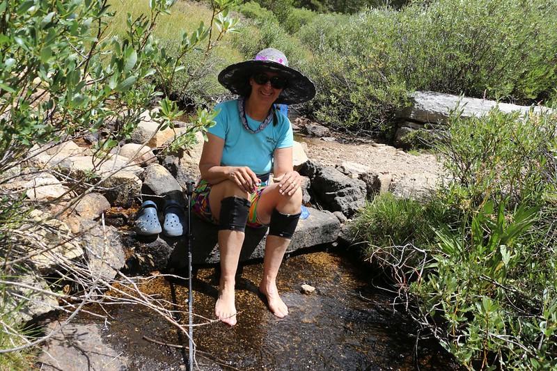 Vicki soaked her feet in a cool creek as we continued downhill toward Wallace Creek on the PCT-JMT-HST
