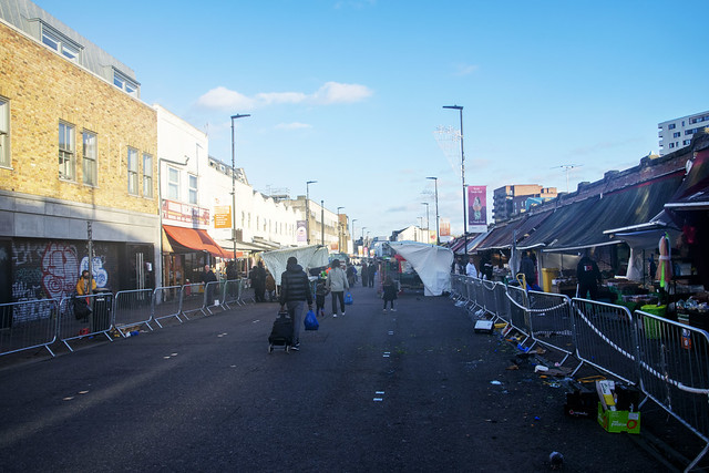 DSC_7528 Dalston Ridley Road Street Market Well intentioned stupid social distancing crowd control for COVID-19 Coronavirus has made things worse: Shorter hours, bottlenecks, Stalls pushed together, people forced closer together. The bottom end of the mar
