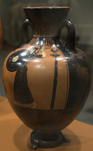 Athenian Black Figure panathenaic amphora representing a discus-thrower and trainer or judge: reverse with Athena
