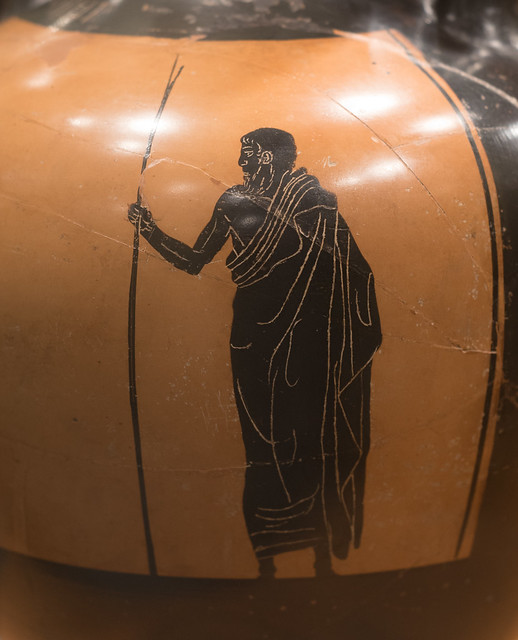 Athenian Black Figure panathenaic amphora representing a discus-thrower and trainer or judge: detail of trainer or judge