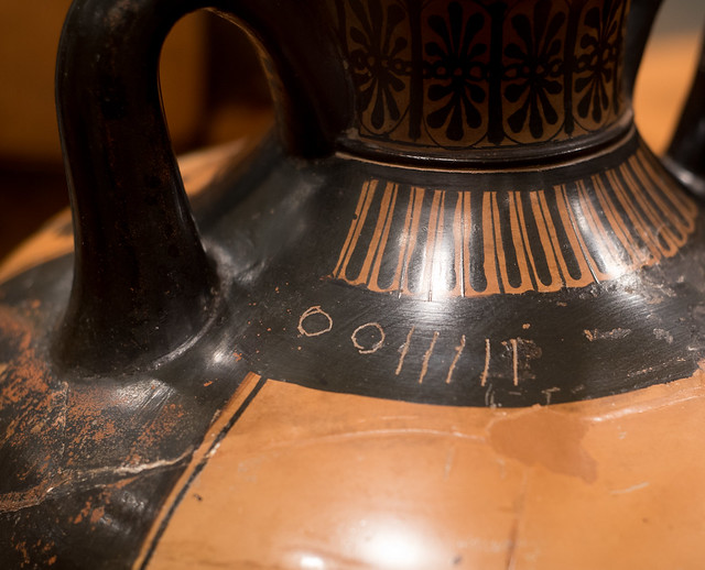 Athenian Black Figure panathenaic amphora representing a discus-thrower and trainer or judge: detail of graffito