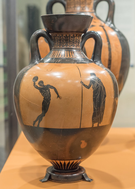Athenian Black Figure panathenaic amphora representing a discus-thrower and trainer or judge