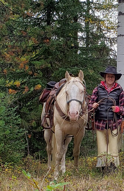 Jessianne Castle of USDA APHIS Wildlife Services with her horse, Thyme