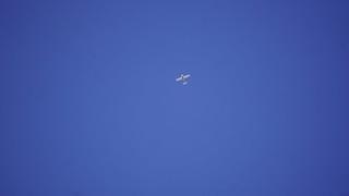 some civilian plane high above
