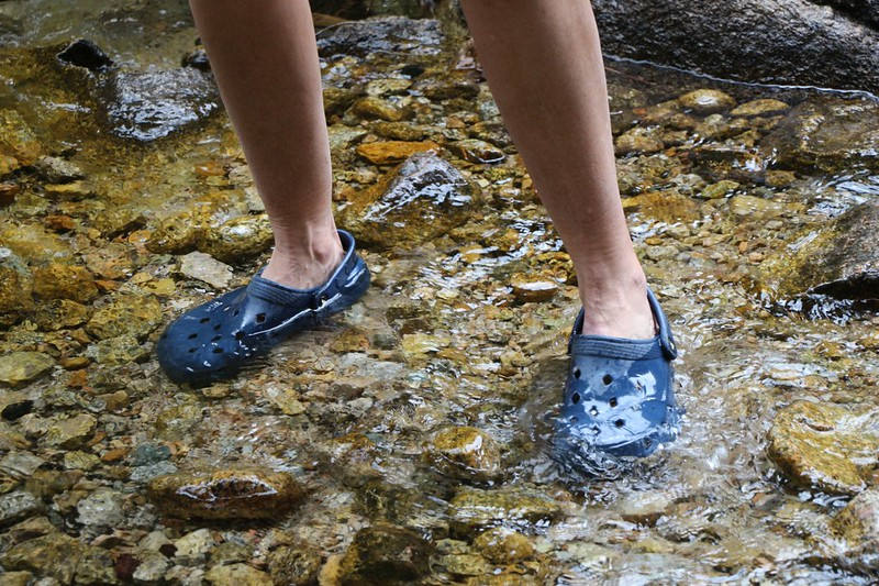 Vicki wearing her crocs in the waters of Whitney Creek, cooling her feet after a long day hiking on the High Sierra Trail