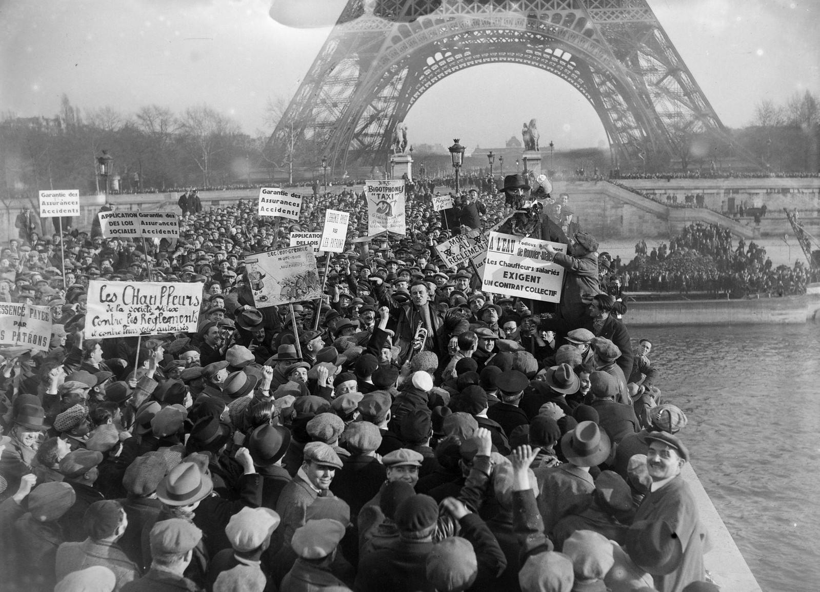 09. 1934. Забастовка таксистов. Толпа движется к Эйфелевой башне