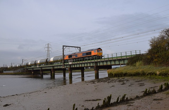 GBRf 66792 hauls the Harwich Refinery - North Walsham Tanks across the River Stour at Cattawade. 11 11 2020