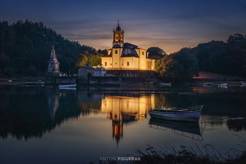 asturias spain barro antonifigueras chruch sunset dusk sea reflections illuminated boats tranquilscene landscape