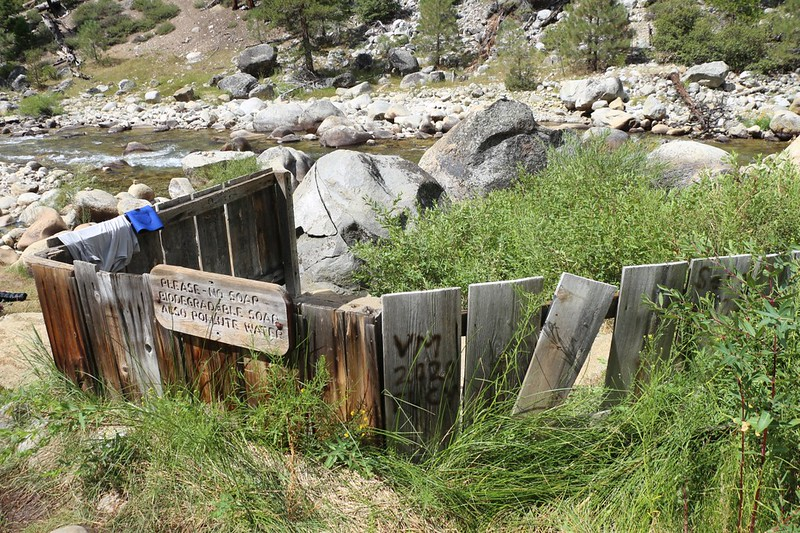 The wooden privacy fence around the cement bathtub at Kern Hot Springs