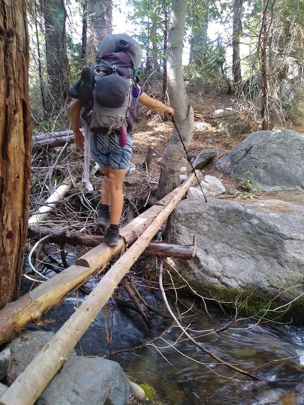 Vicki crossing Rock Creek down in Kern Canyon on a makeshift log bridge, on the High Sierra Trail