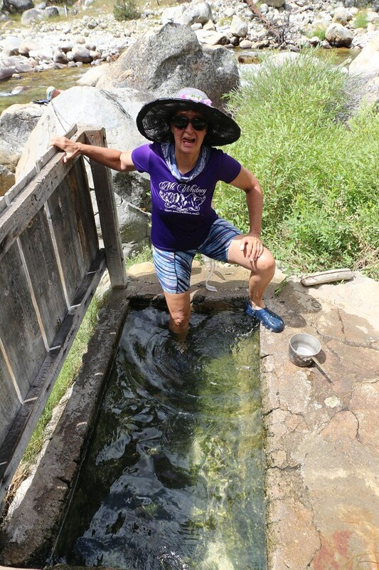 Vicki testing the HOT water in the cement bathtub at Kern Hot Springs