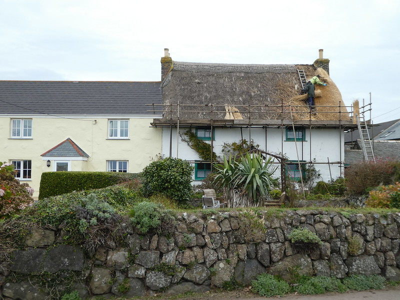 Traditional thatching taking place, Lizard village