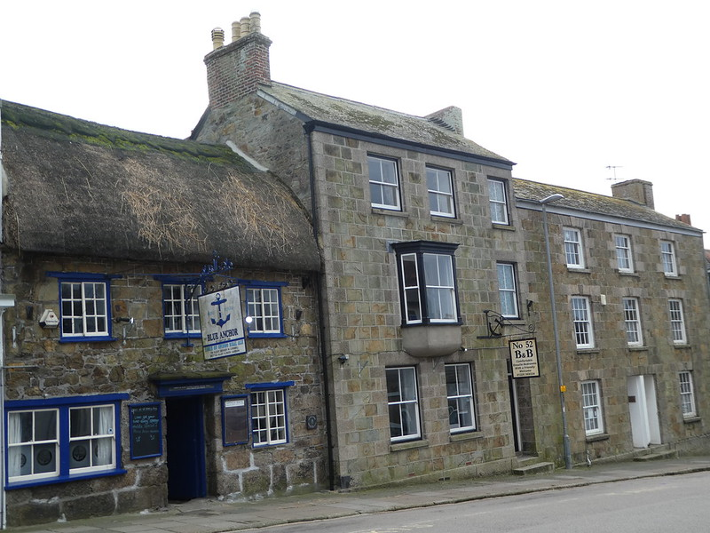 Old stone buildings line Coinagehall Street, Helston