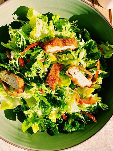 Frisée, little gem, radicchio, bell pepper, feta, green onion, pickled pequin, chicken katsu. Vinaigrette: white wine vinegar, sugar, dijon, horseradish, olive oil, salt.