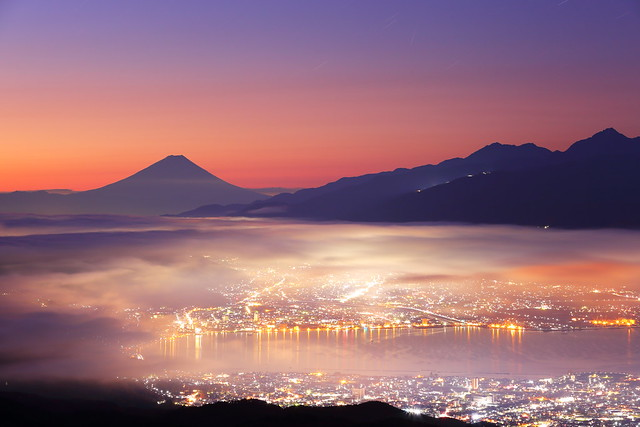 Morning glow ---Mt. Fuji and foggy city---