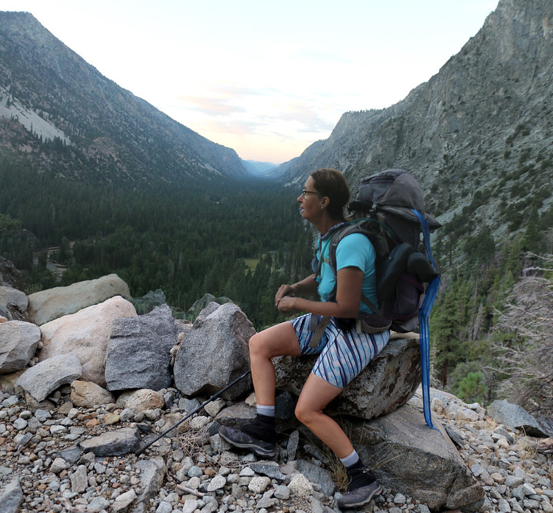 Vicki taking a short break on the High Sierra Trail with a nice view down to Funston Meadow in Kern Canyon