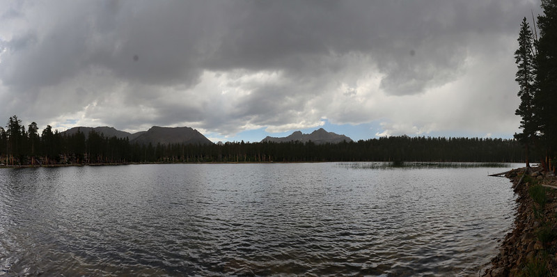 Panorama view of Moraine Lake under stormy clouds as we search for a good campsite