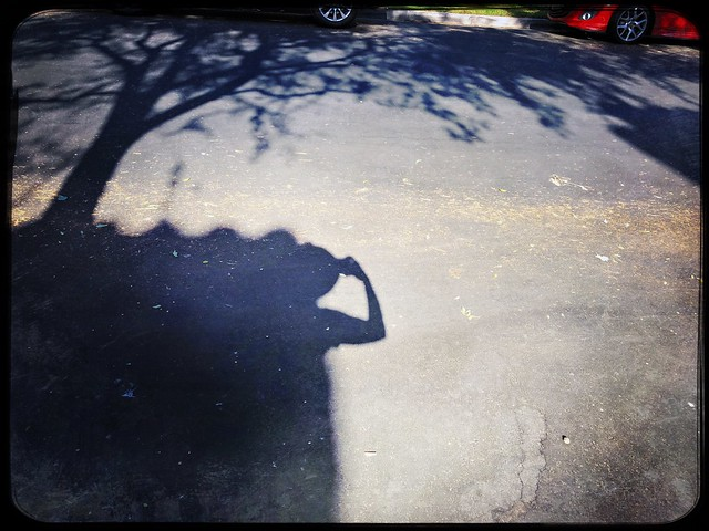 Shadow hunter with a hat at midday .